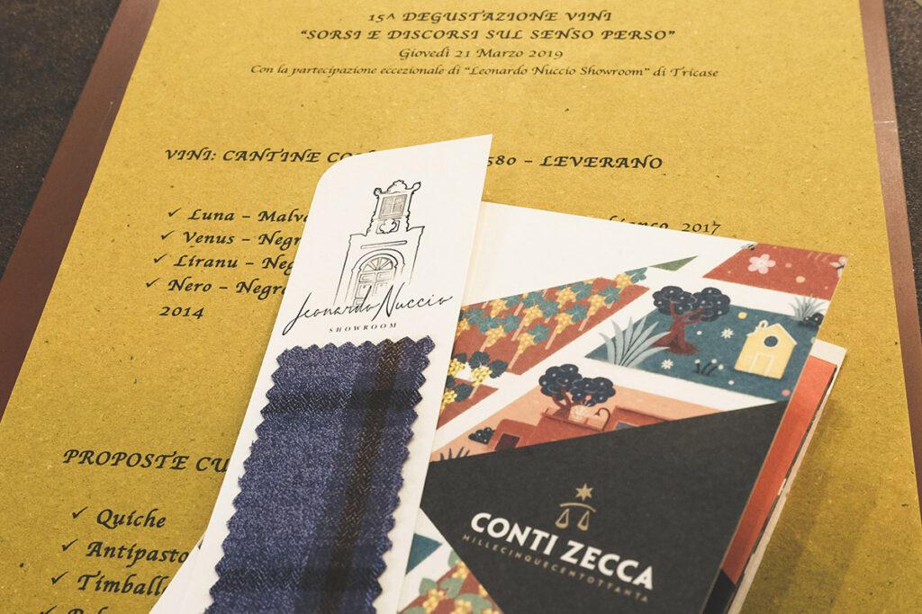 Dettaglio menu degustazione con segnalibro Leonardo Nuccio personalizzato e carta dei vini Conti Zecca